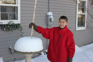 Picture Of 11 yr old measuring snow